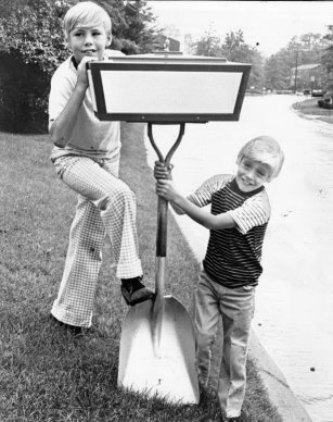 Robbie and Paul Shovel of 141 Thornberry Drive, Churchill, show off their family's easily identifiable mailbox. Photo published Sept. 27, 1973. (Pittsburgh Press)