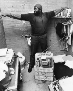 Willie McLendon demonstrates the dimensions of his 7-foot by 8-foot cell. Photo taken Feb. 22, 1983. (Post-Gazette)