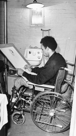 Paralyzed by a bullet, an unnamed inmate exercises by sketching. Photo taken Dec. 1, 1970. (Pittsburgh Press)