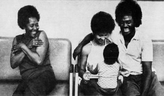 William Haden sits and laughs with his family in Western Penitentiary's visiting room. Photo published Nov. 6, 1977. (Pittsburgh Press)