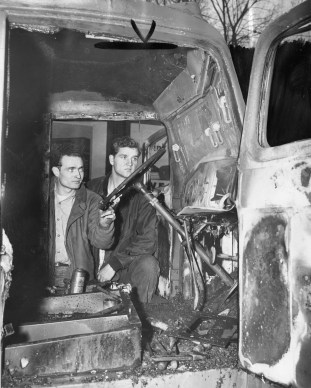 James Alucci and his brother-in-law Stanley Nasiatka of Waynesburg examine the cab of their destroyed truck. A fire bomb was tossed into the truck. Photo published Nov. 25, 1946. (Pittsburgh Press)