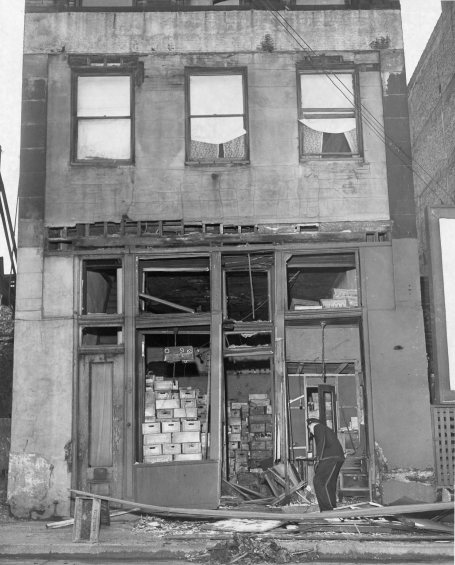Police inspect the Home Beer Distributing Co. at 810 Webster Ave after a dynamite bomb destroyed much of its storefront. Photo published Jan. 21, 1947. (Pittsburgh Press)