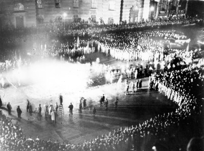 "A large crowd gathers to witness the book burning at Opera Square in Berlin, Germany on May 10, 1933. Students threw a thousand torches on the bonfire and seized ""un-German"" books from trucks and hurled them into the blaze amid cheers. (Associated Press)"
