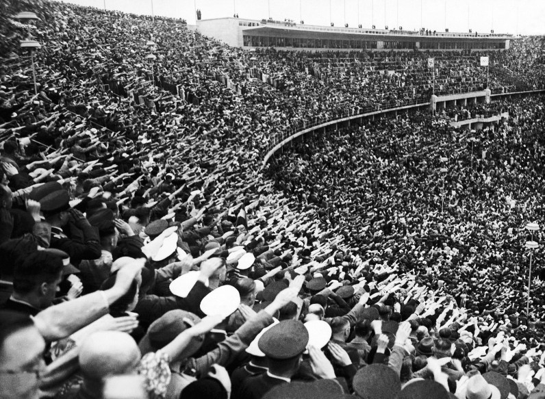 Pictured is part of the vast crowd saluting the athletes during their entry into the Olympic stadium on August 1, 1936 in Berlin, Germany. (Associated Press)