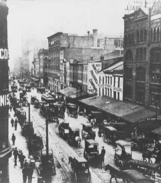 """""""Wagons, streetcars and horse-carts crowded Liberty Avenue before turn of century when Thomas Jenkins ran 'Largest Flour and Grocery House in World,' at far end of street,"""" reads the caption for this undated photo that appeared in The Pittsburgh Press in 1981."""
