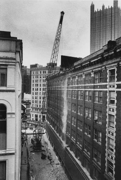 A view of the wrecking ball hitting the Jenkins Arcade taken from Oppenheimer Boulevard. (Kent Badger/Pittsburgh Press)