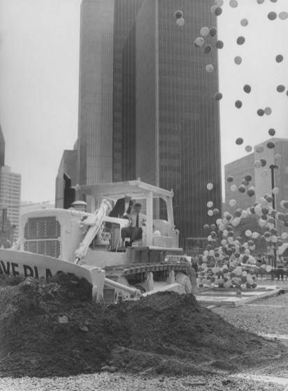 Mayor Richard Caliguiri operates a pink bulldozer to break ground for the new tower on the site of the old Jenkins Arcade on Aug. 29, 1985. (Post-Gazette)