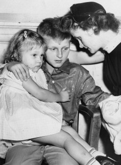 Together briefly at the start of a coroner's inquest are, from left, Janet, Mickey and Shirley Chervenak. Mickey, 10, was the youngest person in Pittsburgh history to be charged with murder.