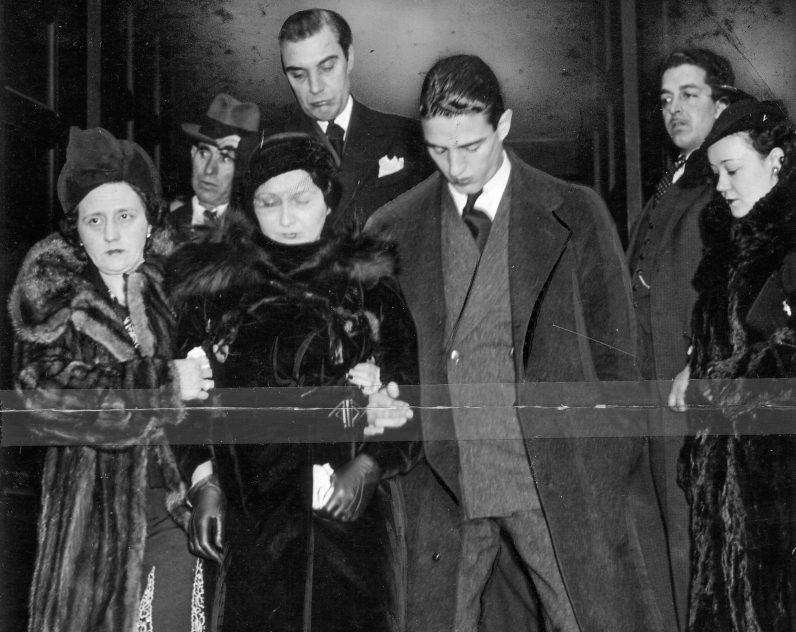 Verona's widow Ida, center, is led from the service by Catherine Tito and Daniel Verona. (Courtesy of John G. Verona)