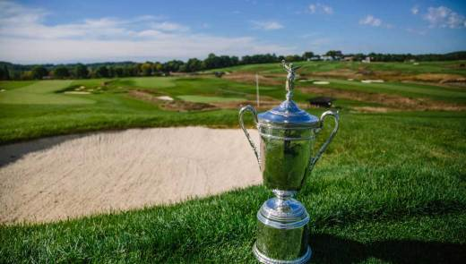 The U.S. Open Trophy is seen above a bunker along the third fairway at Oakmont Country Club. (Andrew Rush/Pittsburgh Post-Gazette)