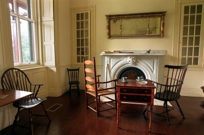 The home is unfurnished, except for changing vignettes. The current one, on view inthe small parlor of the brick house, sets the scene for Gallatin and Lafayette sitting for tea during the statemen's visit in 1825.