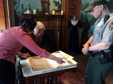 George Relic (center) and Chip Nelson, National Park Service unit manager for Friendship Hill, are shown in West Overton's formal parlor with Registrar Stephanie Koller. An authentic letter signed by Albert Gallatin was transferred from West Overton to the Friendship Hill Associatio.