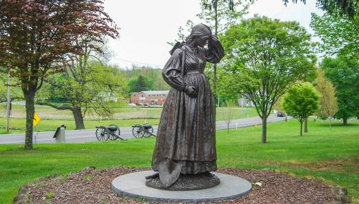A statue of Elizabeth Masser Thorn at the Evergreen Cemetery Gatehouse. Elizabeth took over as caretaker of the cemetery when her husband, Peter Thorn, joined the Union Army. When the war spilled into Gettysburg, Elizabeth, who was six months pregnant at the time, and her elderly father dug graves for fallen soldiers in the weeks following the battle. (Stephanie Ritenbaugh/Post-Gazette)