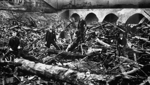 This photo released by the Johnstown Flood Museum shows the debris that began to pile up against Johnstown, Pa.'s stone bridge and caught fire after the South Fork Dam gave way on May 31, 1889 killing 2,209 people. More than 116 years before Hurricane Katrina destroyed New Orleans, a flood in Johnstown exposed the rift between rich and poor, the kindness of strangers and, in the end, the power of the human spirit to rebuild. (AP Photo/Johnstown Flood Museum)