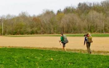 Thru-hikers Tom Spies (left) of Lee, Mass., and Mike Marchand, of Courtice, Ontario, near Toronto, hike on farm fields just south of Boiling Springs where the AT was relocated in the early 1990s. (Don Hopey/Pittsburgh Post-Gazette)
