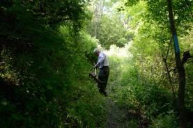 Ron Rice widens the trail that runs along Pry Road. (Darrell Sapp/Post-Gazette)