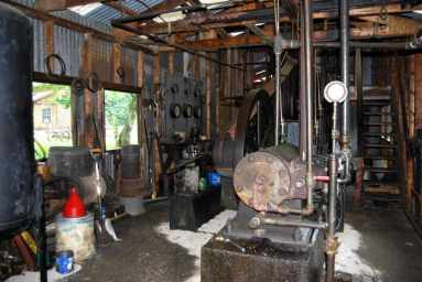 Inside the Central Power facility at the Drake Well Museum in Venango County. The power facility housed an engine that pumped oil from multiple wells at once. A barker on the exhaust pipe gives it a distinctive sound that allows the well operators to hear from a distance if their well was running properly. Each operator could customize the sound to track their particular wells.