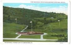 Old postcard shows the way the reconstructed Fort Necessity used to look, until archaeologists determined that the wooden stockade actually was circular.