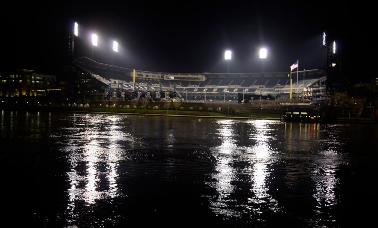 The bright lights of   PNC Park  loom over the Allegheny River early Monday morning.  (Darrell Sapp/Post-Gazette)