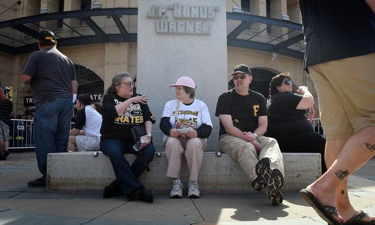 Debbie Marafioti of Monroeville, Joan Newill of Greensburg and Charlie Love of Butler waited for gates to open. (Steve Mellon/Post-Gazette