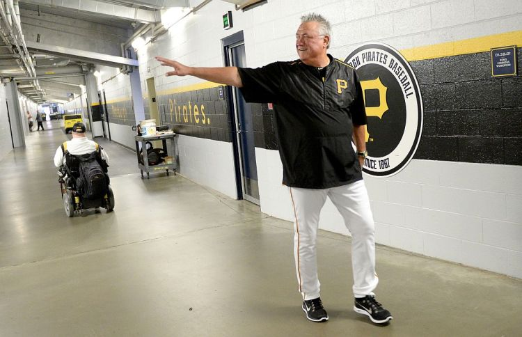 Pirates manager Clint Hurdle walks to a press conference Monday morning before his team's home opener against the Tigers at PNC Park. (Matt Freed/Post-Gazette)