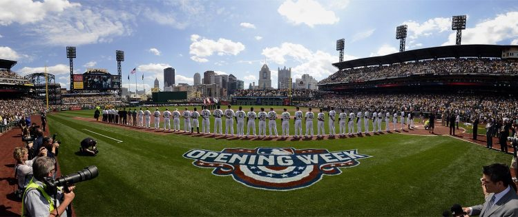 Players stand for the National Anthem moments before the first pitch. (Steve Mellon/Post-Gazette)