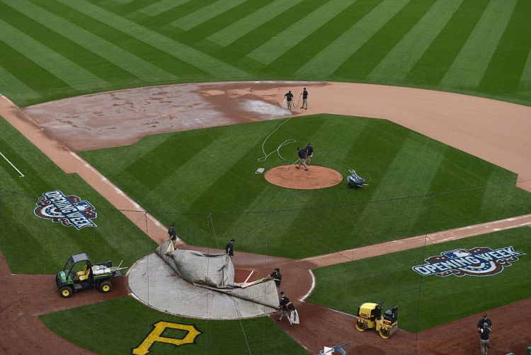 The grounds crew works on the field after the end the Pirates Opening Day game against the Detroit Tigers at PNC Park on Monday (Rebecca Droke/Post-Gazette)