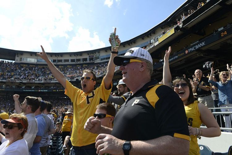 Dan Nagy, left, of High Point, NC, and his dad Bill Nagy, center, celebrate a home run by Pedro Alvarez in the 7th inning, during the Pirates Opening Day game against the Detroit Tigers at PNC Park on Monday, April 13, 2015. (Rebecca Droke/Post-Gazette)