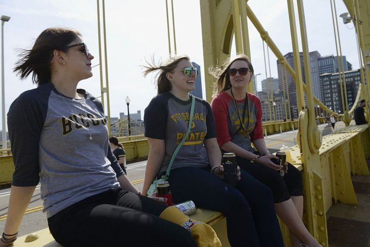 Paige LaBrozzi of Butler, Sarah Langy of Etna and Ashlie Harrington of Bradford hang out on the Roberto Clemente Bridge before the opening day game against the Detroit Tigers at PNC Park on the North Side Monday. (Rebecca Droke/Post-Gazette)