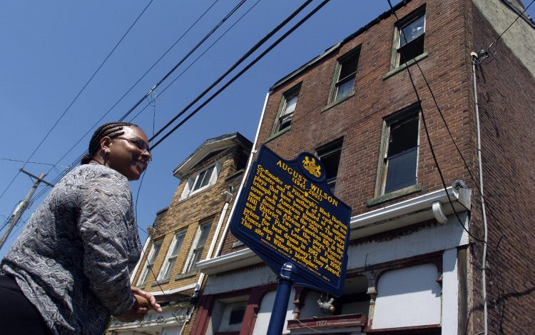 Sakina Ansari-Wilson, daughter of August Wilson, immediately following the unveiling of the historical marker  at Wilson's childhood home at 1727 Bedford Ave. in the Hill District. (Andy Starnes/Post-Gazette)