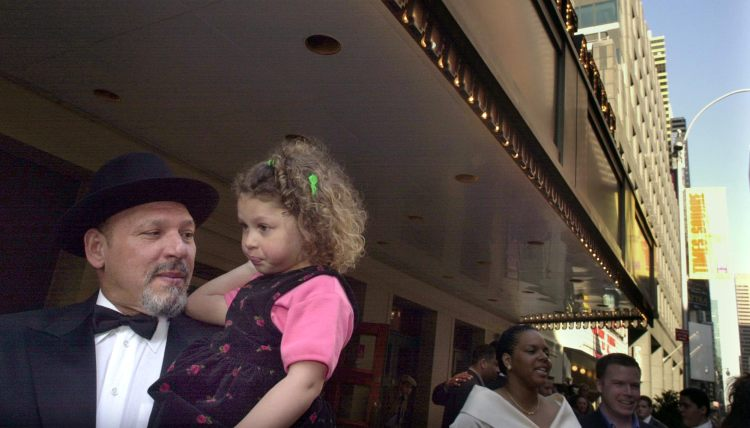 """At the 2001 New York City  premiere of """"King Hedley II"""",  playwright August Wilson who holds his daughter Azula,3, in front of the Virginia Theatre.  (Bill Wade/Post-Gazette)"""