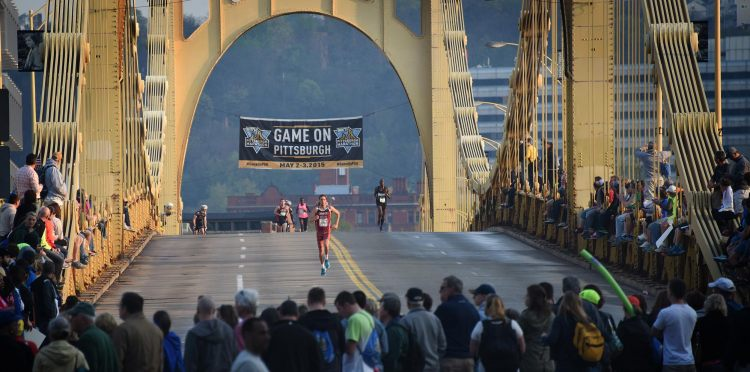 A crowd gathers on the Rachel Carson Bridge to cheer on the elite runners.  (Steve Mellon/Post-Gazette)