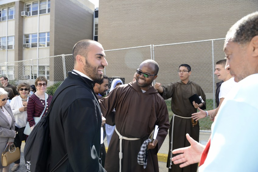 Monks greet each other as they wait in line for the canonization Mass of Junipero Serra by Pope Francis at the Basilica of the National Shrine of the Immaculate Conception in Washington, D.C., on Wednesday, Sept. 23, 2015.