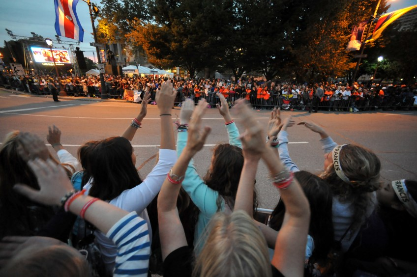 """Oakland Catholic High School students sing along to the song """"Family Matters"""" as they wait for the  papal parade to begin along the Benjamin Franklin Parkway on Saturday, Sept. 26. (Rebecca Droke/Post-Gazette)"""