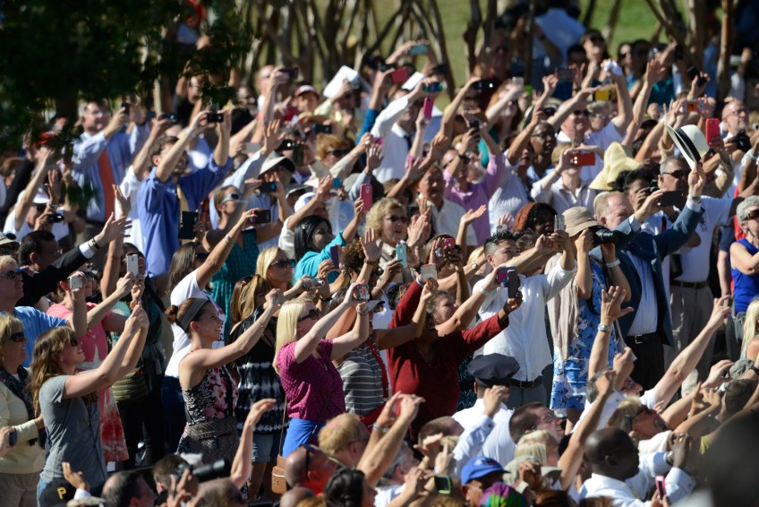 The crowd waves and points their phones toward Pope Francis, who toured the crowd in his pope mobile upon arrival at the Basilica of the National Shrine of the Immaculate Conception for the canonization Mass for Junipero Serra on Wednesday.