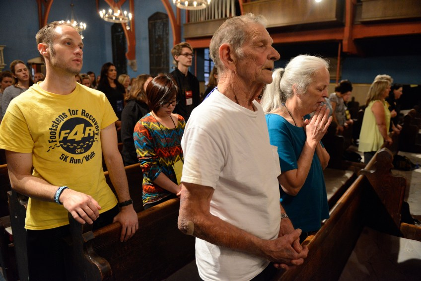 Lou and Dee Zimmerman of Evans City joins other Pittsburgh and Erie pilgrims attending Mass held by Father Michael Roche at the First Unitarian Church in Center City Philadelphia on Friday. Father Roche is the pastor at the Zimmermans' church, St. Mathias.