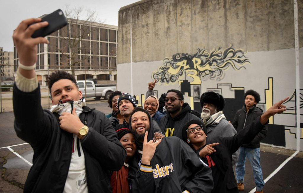 Members of 1Hood Media pose for a selfie in East Liberty on Friday, May 17, 2017. (Steve Mellon/Post-Gazette)