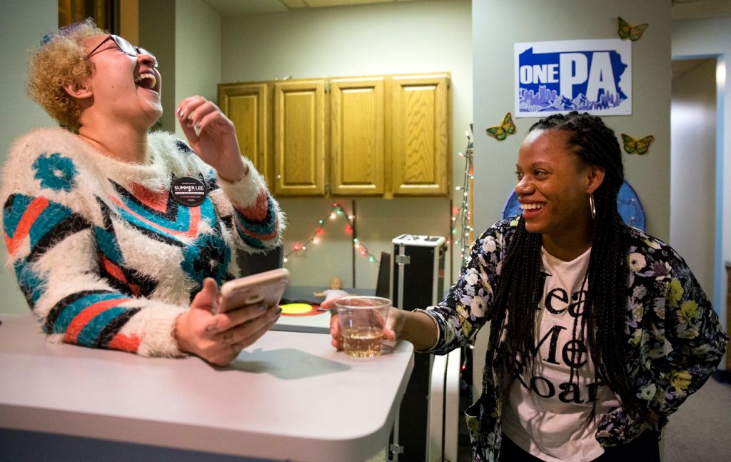 Summer Lee, a state House District 34 candidate, jokes with Lauren Lynch-Novakovic, of North Braddock, in a gathering of the Pennsylvania Student Power Network on Wednesday, Feb. 14, 2018, in North Side. (Antonella Crescimbeni/Post-Gazette)