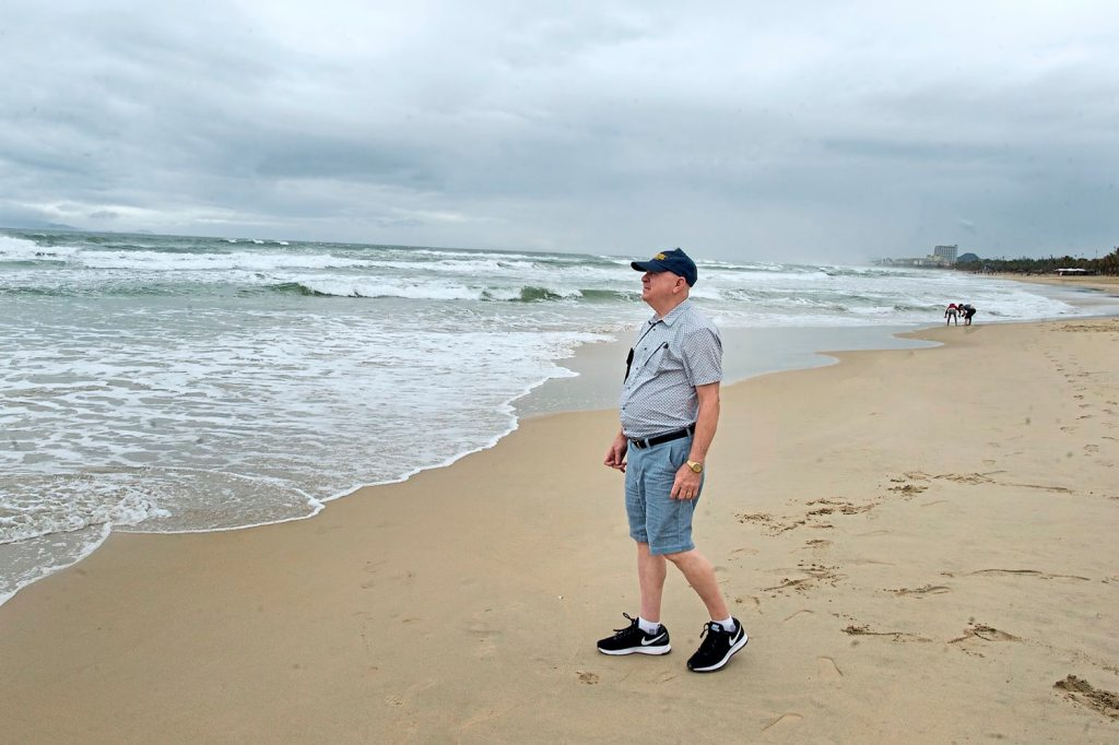 George Haught of Monaca walks along China Beach Monday, Jan. 29, 2018, in Da Nang, Vietnam. Mr. Haught served with the U.S. Marines during the Battle of Hue and was awarded three Purple Hearts for service in Vietnam. (Nate Guidry/Post-Gazette)