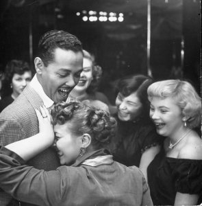 White fans greet Pittsburgh singer Billy Eckstine outside New York's Bop City in 1950, when he was at the pinnacle of his popularity. The image created controversy, adversely affecting Eckstine's career. (Photo by Martha Holmes/The LIFE Picture Collection/Getty Images)