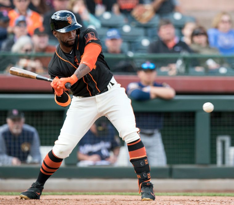 Andrew McCutchen swings in his first spring training game with the Giants. (Steph Chambers/Post-Gazette)