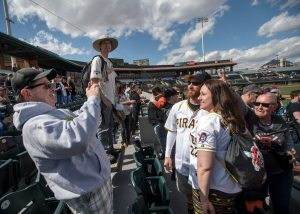 Pirates fans Bobby Stechnij and Kelly McMahon of Gilbert, Ariz., have their photo taken before Andrew McCutchen's first spring training game with the Giants. (Steph Chambers/Post-Gazette)