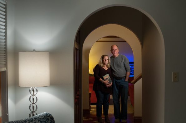 Tina and Chris Flowers, both 55, stand for a portrait in their home. (Stephanie Strasburg/Post-Gazette)