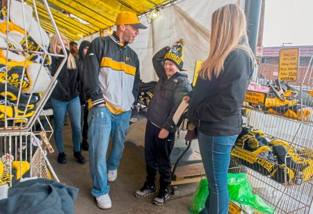 Dylan Brooks, 11, of Youngstown, OH.,  tries a Penguins knit hat at Yinzers while his mom Nichole, 32, on Friday, March 30, 2018 in the Strip District. (Lake Fong/Post-Gazette)