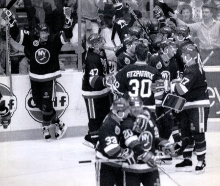 The Islanders celebrate their upset victory against the Penguins in Game 7 of the Patrick Division final on May 14, 1993, at Civic Arena. (Al Fuchs/Associated Press file)