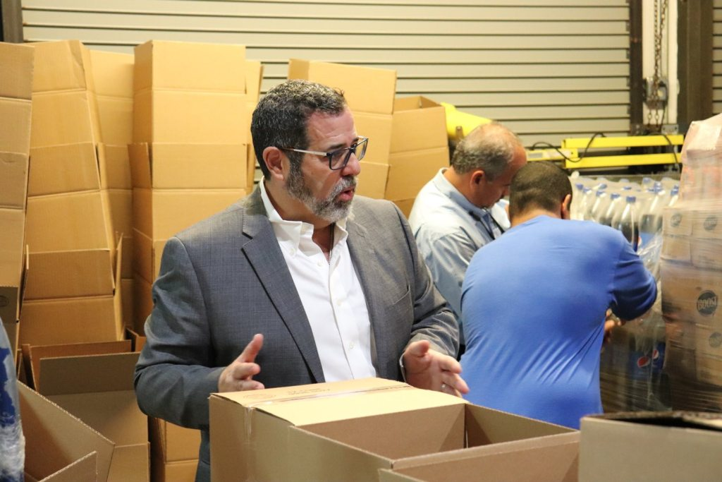 Raul Rodriguez is president of Luis Garraton Inc., a logistics company in Puerto Rico with which the Pirates worked to distribute emergency supplies after Hurricane Maria. Here, he directs a group of people packing relief supplies earlier this year at his warehouse in Caguas. (Elizabeth Bloom/Post-Gazette)