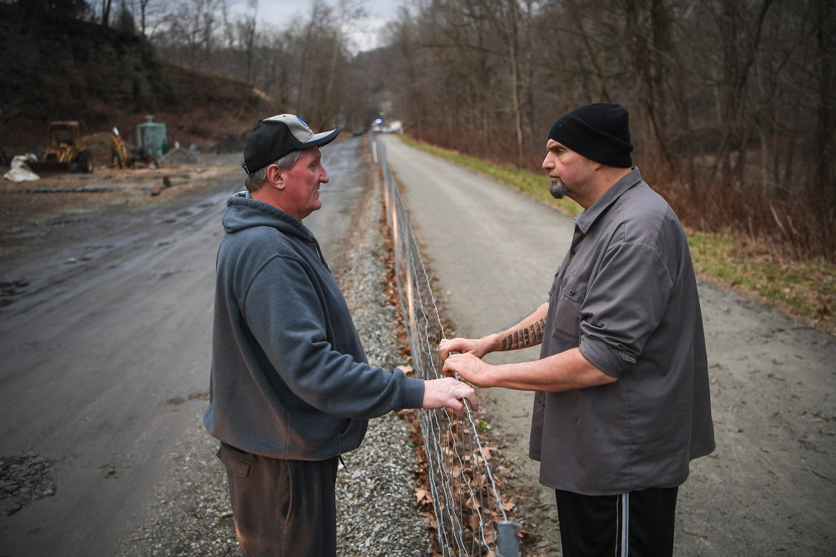 Lieutenant Governor-elect John Fetterman, right, talks to Charles Prodanovich, of Trafford, who recognized him while he was on a walk with his family, Tuesday, Jan. 8, 2019, on the Westmoreland Heritage Trail in Trafford.