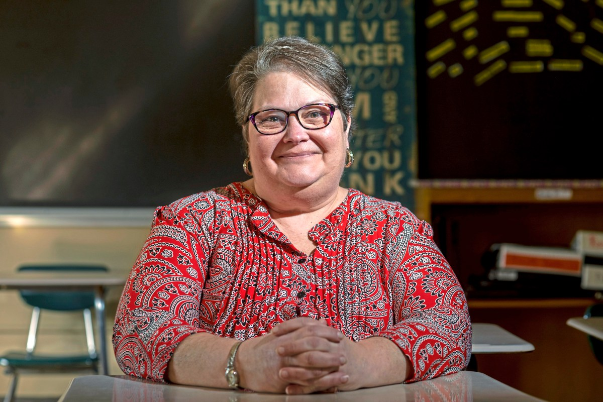 """Barb Mohan of the North Side sits for a portrait, Friday, Feb. 15, 2019, at Perry Traditional Academy in the North Side. ÒI remember when people spray painted stuff on the sidewalk and the principal had to cover it up with carpets."""" Barb Mohan was part of Pittsburgh Perry High SchoolÕs Class of 1977 who were the first students to attend the Northside school all four years after it formally integrated in 1973.  (Michael M. Santiago/Post-Gazette)"""