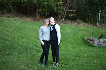 "Colby Love poses with his mother, Kim Love, before Bethel Park High School's homecoming dance in the fall of 2017. Colby, who was struggling with anxiety, depression and gender dysphoria, called that night ""a big turning point"" in his journey. (Courtesy of Colby Love)"