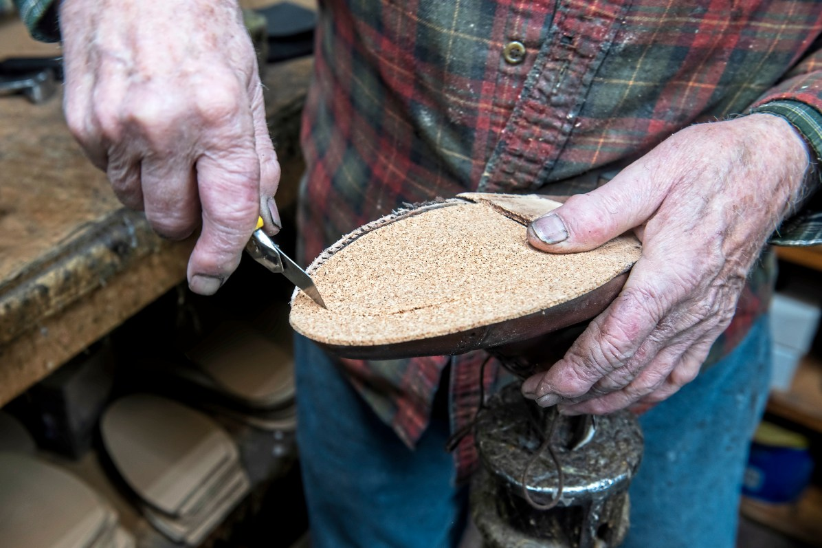 Bill Wells, 81, owner of Charles the Cobbler, works on a customer shoes. (Nate Guidry/Post-Gazette)